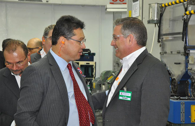 Brett York, President – Essentra Americas (right) welcomes Minister Leite (left) to site